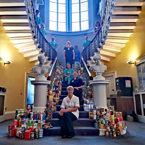 Leeds Health Workers Donate Enough Food to Foodbank to Fill an 8 Metre High Staircase thumbnail